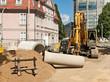 Kanalbau und Strassenbau - Rohre aus Beton und ein Bagger