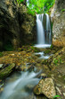 Deep forest waterfalls in the Transylvanian Alps