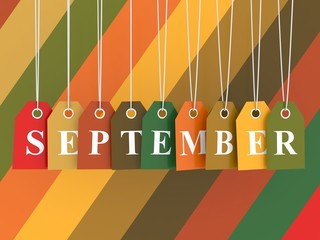 September tag on colored hanging labels. Fall colors background