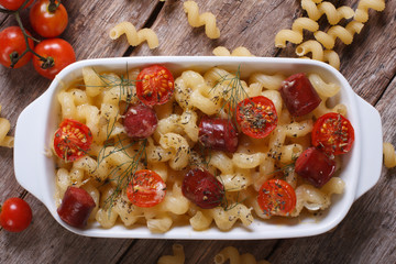 pasta baked with cherry tomatoes and sausages top view