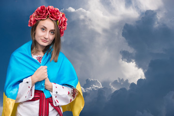 Portrait of attractive young girl in national dress with Ukraini