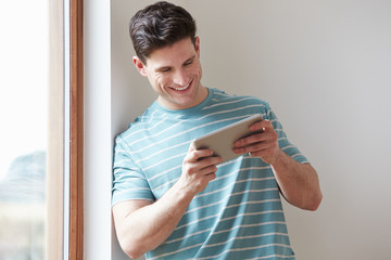 Man Using Digital Tablet At Home