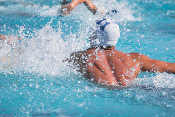 water polo player shooting