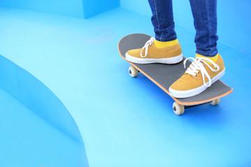 woman skateboarder legs on skatepark