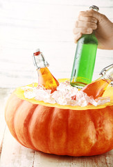 Hand Taking Cold Drink from Pumpkin Ice Bucket