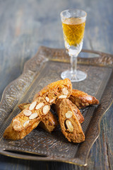 Biscotti and a glass of liquor.