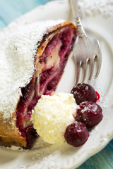 Plate with cherry strudel and fork.