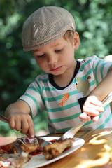 Child eating chicken