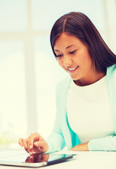 smiling student girl with tablet pc