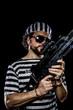 Freedom .Prison riot concept. Man holding a machine gun, prisone