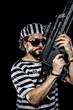 Violence .Prison riot concept. Man holding a machine gun, prison