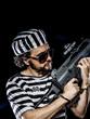 Opposition .Prison riot concept. Man holding a machine gun, pris