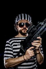 Prisoner .Prison riot concept. Man holding a machine gun, prison
