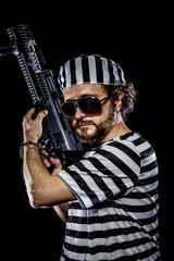 protest .Prison riot concept. Man holding a machine gun, prisone