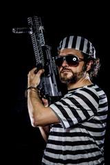 supression .Prison riot concept. Man holding a machine gun, pris