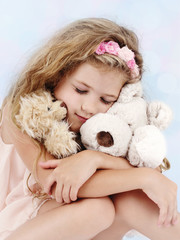Beautiful little girl dreaming with teddy bear