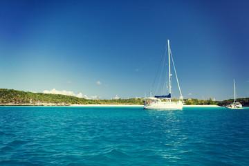 white boat at blue sea