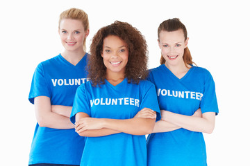 Studio Portrait Of Three Women Wearing Volunteer T Shirts