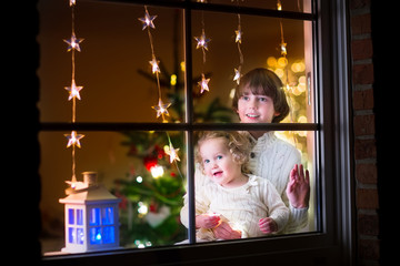 Kids at window on Christmas eve