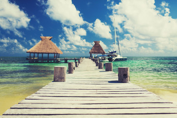 wooden pier with blue water around