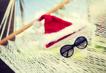 hammock with santa helper hat and shades