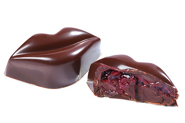 Chocolate candy in form of lips with cherry