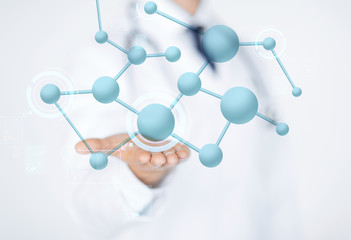close up of male doctor hand with molecules