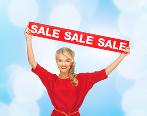 woman in red dress with sale sign