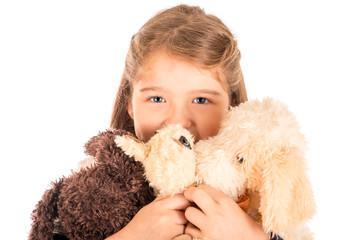 Little girl Holding stuffed animals