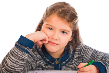 Beautiful little girl bored doing homework