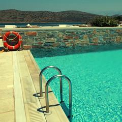Patio and resort pool overlooking the Mediterranean sea