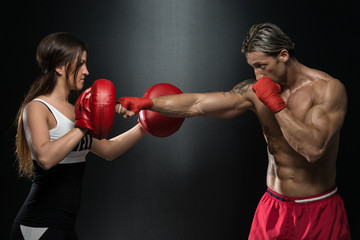 Young Fit Man Fighting A Woman