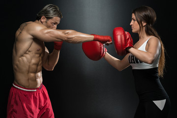 Couple Exercising Punching
