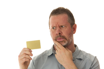 Man Holding Credit Card and Looking Concerned