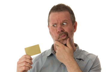 Man Looking Skeptically at Credit Card