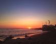 canvas print picture - tramonto in spiaggia