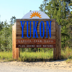 Sign welcoming visitors to Yukon Territory, Canada