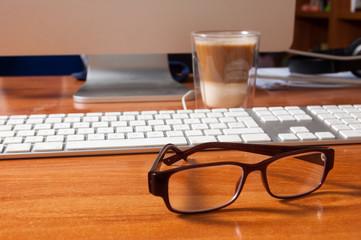 Glasses on an office desk.
