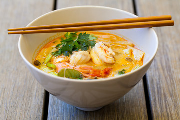 Bowl of traditional Thai tom yam soup