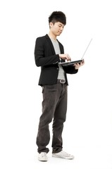 Isolated Young Business man With Laptop