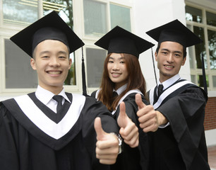 graduation group two man and girl smiling on campus
