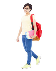 smiling young student girl standing and holding book