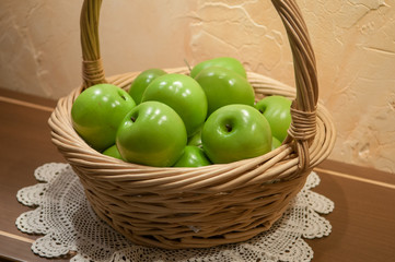 Green apples in basket, selective focus
