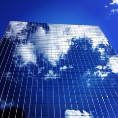 clouds reflecting in highrise windows