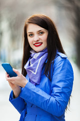 young woman using smartphone at street