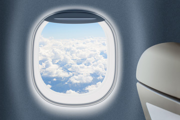 Aeroplane or jet window with clouds behind, traveling concept.