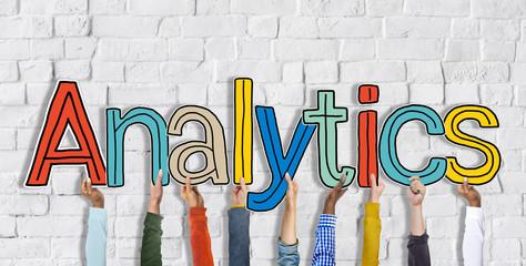 Multiethnic Group of Hands Holding Word Analytics