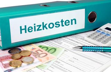 Heizkosten Ordner mit Geld und Taschenrechner, türkis