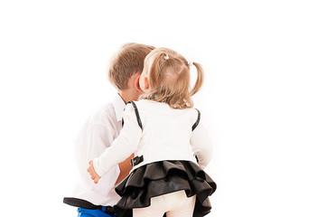little girl kissing a boy