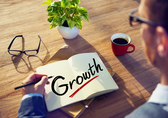 Businessman with Note About Growth Concepts